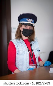 Viseu de Sus, Maramures / Romania - September 20 2020: Girl with mask working for forestry railway known as Mocanita from North Romania