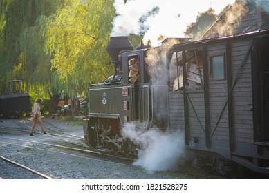 Viseu de Sus, Maramures / Romania - September 1 2020: Steam Train Mocanita waiting a lady to cross over the railway