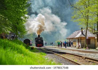 Viseu de Sus, Maramures, Romania - May 21 2021: Steam Train in railway station Romanian mountains