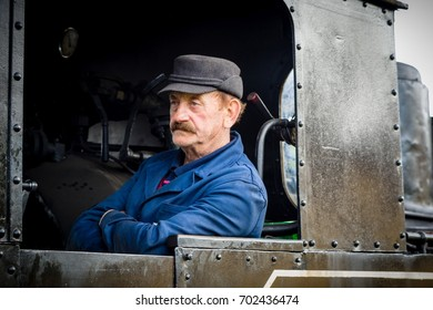 VISEU DE SUS - MAY 7: Driver of wood-burning steam train on May 7, 2016 in Viseu de Sus, Romania. Forestry railway was used for transporting timber, now transport tourists.