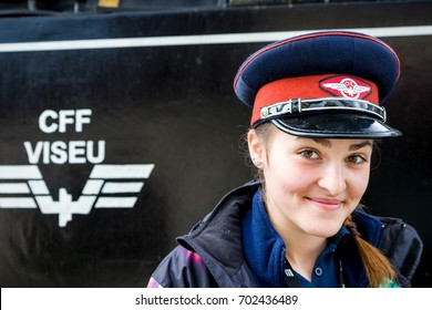 VISEU DE SUS - MAY 7: Conductress of wood-burning steam train on May 7, 2016 in Viseu de Sus, Romania. Forestry railway was used for transporting timber, now transport tourists.