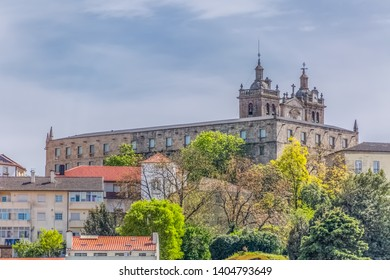 Viseu / Portugal - 04 16 2019 : View at the Viseu city, with Cathedral of Viseu on top, historical monument with various classical styles, architectural icon of the city of Viseu, Portugal