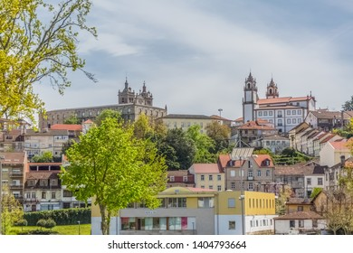 Viseu / Portugal - 04 16 2019 : View at the Viseu city, with Cathedral of Viseu and Church of Mercy on top, monuments of various classical styles, architectural icons of the city of Viseu, Portugal