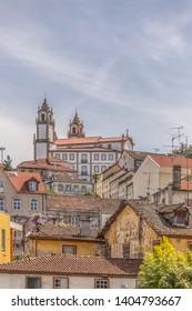 Viseu / Portugal - 04 16 2019 : View at the Viseu city, Church of Mercy on top, Igreja da Misericordia, baroque style monument, architectural icon of the city of Viseu, Portugal