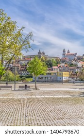 Viseu / Portugal - 04 16 2019 : View at the Viseu city, with Cathedral of Viseu and Church of Mercy on top, monuments of various classical styles, architectural icons of the city of Viseu