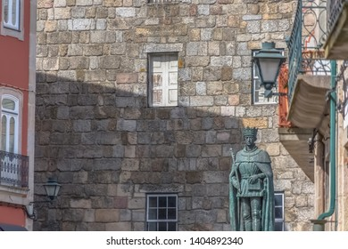 Viseu / Portugal - 04 16 2019 : Detailed view at the lateral facade of the Cathedral of Viseu, Sé Catedral de Viseu, D. Duarte statue, architectural icon of the city of Viseu, Portugal