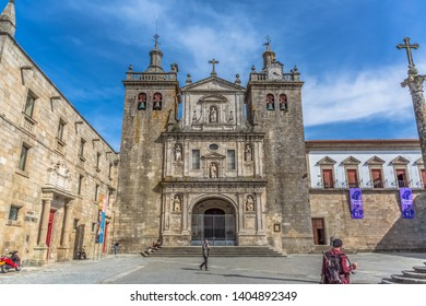 Viseu / Portugal - 04 16 2019 : View at the front facade of the Cathedral of Viseu, Adro da Sé Catedral de Viseu, tourist people, architectural icon of the city of Viseu, Portugal