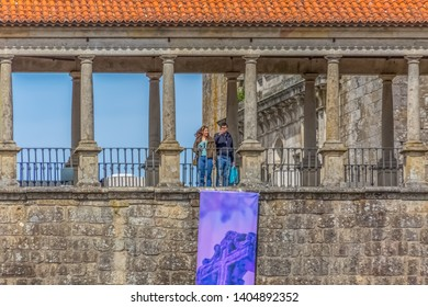 Viseu / Portugal - 04 16 2019 : Detailed view at the lateral facade of the Cathedral of Viseu, Sé Catedral de Viseu, column gallery with a couple, architectural icon of the city of Viseu, Portugal