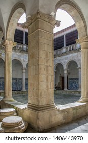 Viseu / Portugal - 04 16 2019 : View at the interior cloister on the Cathedral of Viseu, romanesque style columns gallery, Portugal