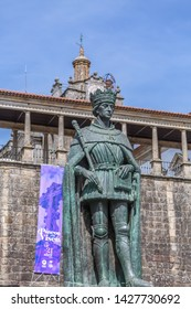 Viseu / Portugal - 04 16 2019 : Detailed view at the lateral facade of the Cathedral of Viseu, Sé Cathedral de Viseu, D. Duarte statue, architectural icon of the city of Viseu, Portugal