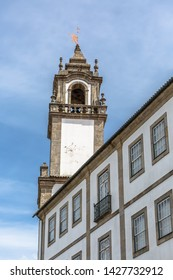 Viseu / Portugal - 04 16 2019 : View of a tower at the Church of Mercy, baroque style monument, architectural icon of the city of Viseu, in Portugal