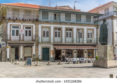 Viseu / Portugal - 04 16 2019 : View at the D. Duarte plaza, D. Duarte statue back and vernacular architecture buildings on historical zone in city of Viseu, Portugal
