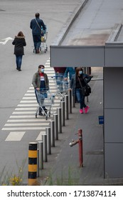 Viseu , Portugal - April 24 , 2020 : People wait for long lines at supermarkets due to the social distance caused by the Covid 19 virus, a worldwide pandemic