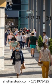 Viseu , Portugal - June 08 , 2020 : People in the shopping center doing their shopping safely with a face mask, due to the pandemic of covid 19, corona virus in Portugal