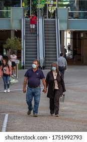 Viseu , Portugal - June 08 , 2020 : Loving elderly couple, protected with the face mask due to the covid 19 pandemic, after doing their shopping