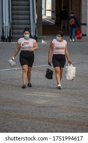 Viseu , Portugal - June 08 , 2020 : Two women protected with face mask after doing their grocery shopping. Social distance.