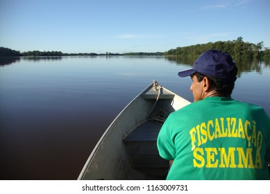 Viseu/Para/Brazil - May 18, 2011: environmental monitoring agent of the Environment Secretariat (SEMMA) of the municipality of Viseu, navigating the Rio Gurupi, which borders the state of Maranhao