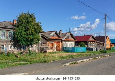 VISIM, RUSSIA - JULY 5, 2019. Russian village in summer, view of the village street with old and new traditional wooden houses. Village of Visim, Sverdlovsk region, Russia.