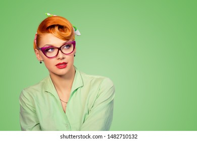 Vision. Closeup portrait confident successful beautiful attractive young woman fashion girl posing with sunglasses looking to side isolated on green background Positive human emotion facial expression