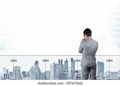 Vision concept, Businessman looking something in city.