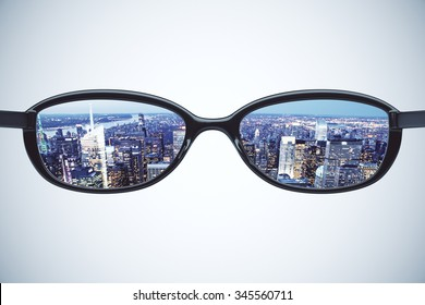 Vision concept with eyeglasses and night city view