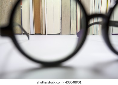 Vision concept. Looking at a part of bookshelf through my eyeglasses when i lay down on my desk