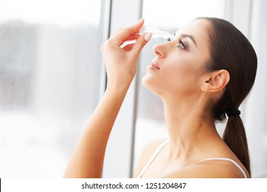 Vision concept. Young Beautiful Woman With Eyedrops.