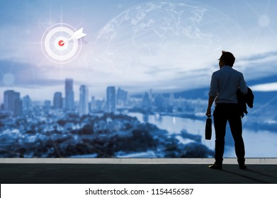 Vision concept, Young business man on the roof of the building and look through to find out goals and success with ambition and commitment to success in the job.
