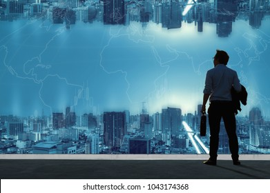 Vision Concepts, Successful businessmen stand on top of the building and look to the modern urban landscape.