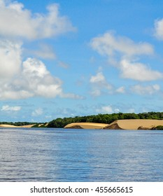 Vision of the dunes with a river and a forest around. Lencois Maranhenses National Park, Brazil