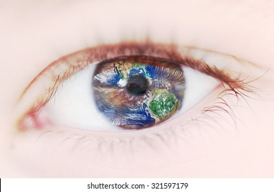 Vision of Planet Earth inside a child's eye