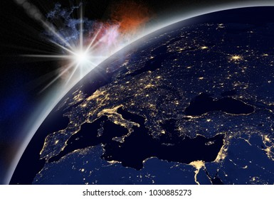 vision of sunrise over the earth visible from space. city lights visible on the continents.