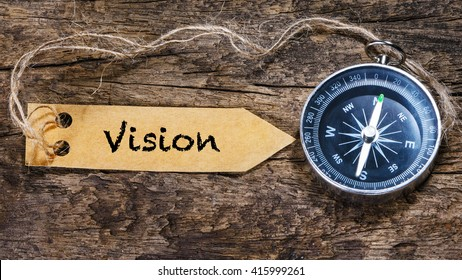 Vision word - Concept handwriting on label with compass