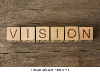 VISION word on wooden cubes