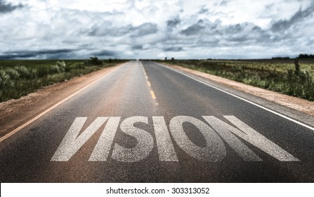 Vision written on road