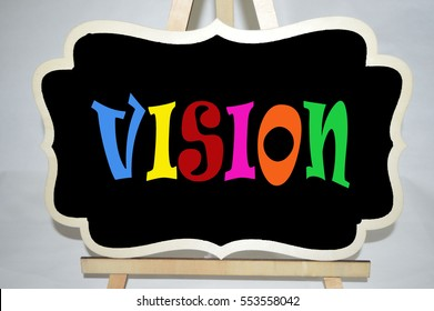 Vision is written on a small black board