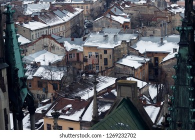 Visit to Lviv. Traveling to Western Ukraine. Lviv from the height. View of Lviv from the Tower of the Cathedral of Olga and Elizabeth. The roofs on which the snow is. The roofs of Lviv