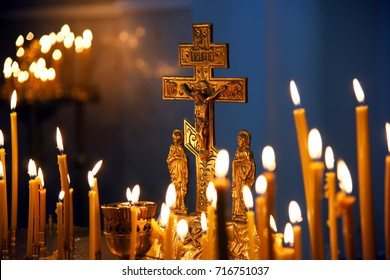 Visit the temple, to light the candles on the stand, the cross in focus