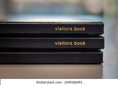 Visitor books at the reception .
