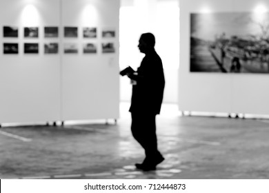 Visitor at photography art gallery exhibition display