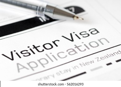 visitor visa application form with ball pen
