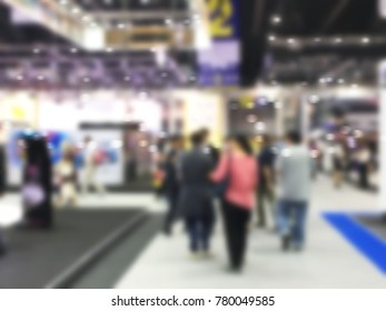 visitor walk in motor show exhibition with abstract blurred background