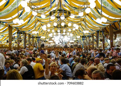 Visitors in a beer tent at the Oktoberfest in Munich, Bavaria, Germany, Europe, 25. September 2013