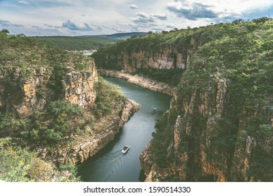 Visitors boats cruising through the canyons of Capitolio in the Serra da Canastra National Park in Brazil