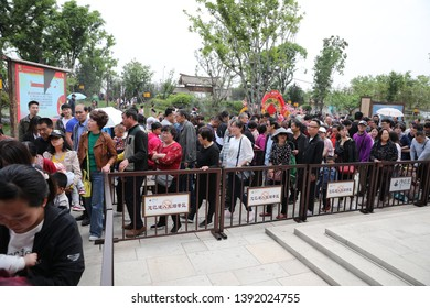 """Visitors to the """"book of songs"""" scenic spot in xi 'an, capital of northwest China's shaanxi province, crowd the han dynasty-style town on May 2, 2019. This is a scenic spot for tourism and leisure."""