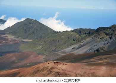 Visitors can hike along trails inside ancient Haleakala crater in Maui Hawaii.