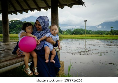 Visitors are enjoying the natural beauty of rice fields in Joglo restaurant, Salatiga, Central Java, Indonesia, December 31, 2017.