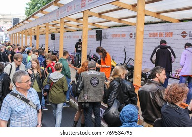 Visitors to the exhibition of motorcycles. St. Petersburg, Russia - 5 August, 2017. The annual Harley-Davidson Festival is held in the center of St. Petersburg.