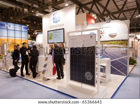 Trade Show Booth Exhibitors : Visitors exhibitors interact hall conenergy trade stock photo