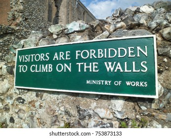 Visitors are forbidden to climb on the walls sign
